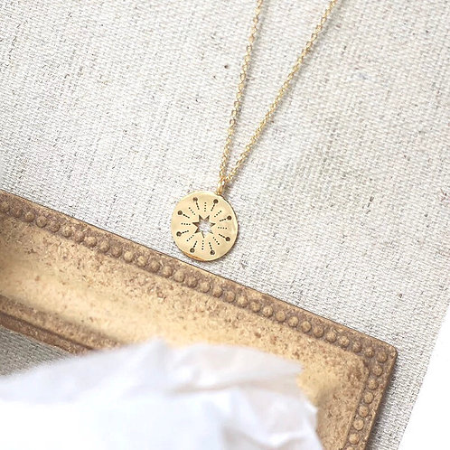 Bright golden star necklace