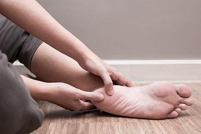 Woman holding foot.jpeg