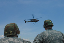 Soldiers Look on as a Mock Helo Rescue