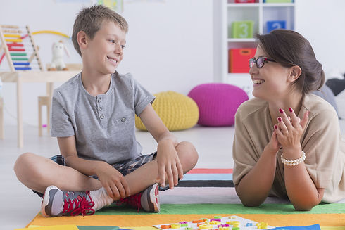 Happy little child during during therapy