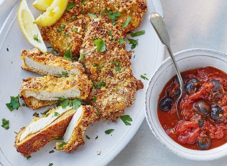 Lemon and garlic chicken schnitzels with quick puttanesca sauce