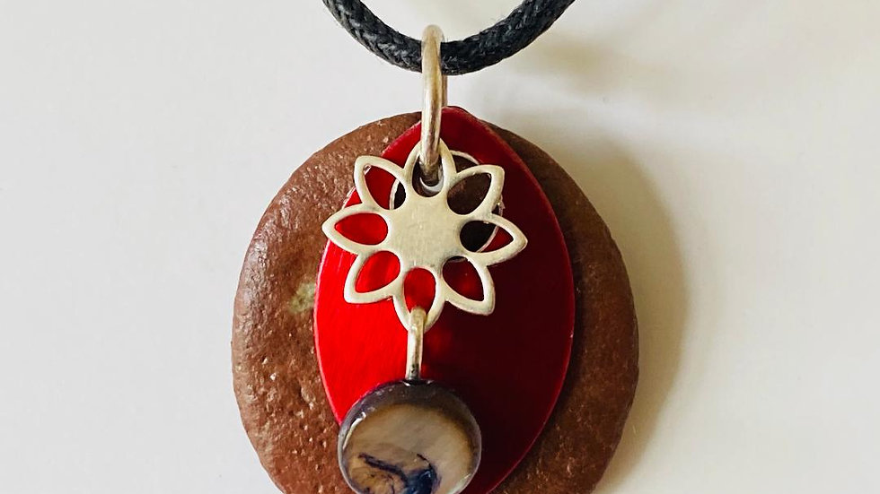 Red Shield Pendant with Flower and Shell and Pebble