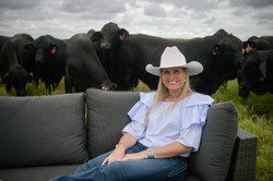 Kellie Silvester with Brangus Bulls