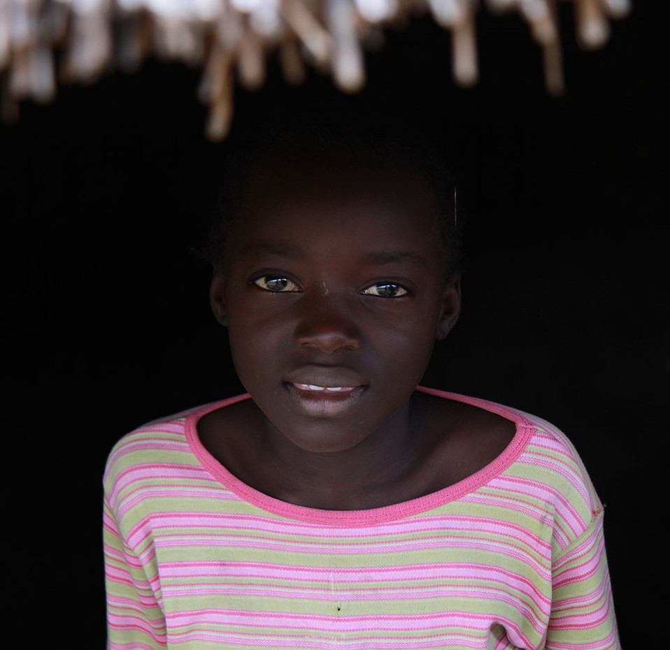 A young girl poses for a photo in rural Nigeria.  2014 Outside Jos, Nigeria
