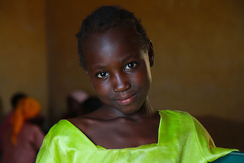 A young girl poses for a photo at a IDP camp in Nigeria.  2014 Jos, Nigeria