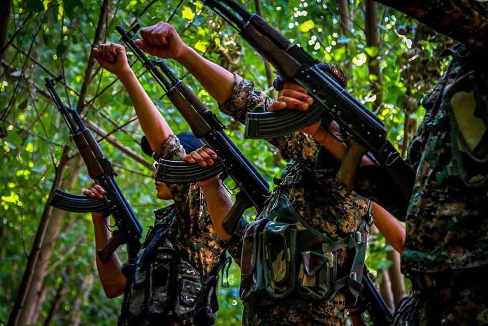 New recruits of the Syriac Military Council train in northeast Syria.  2015 Qamishli, Syria