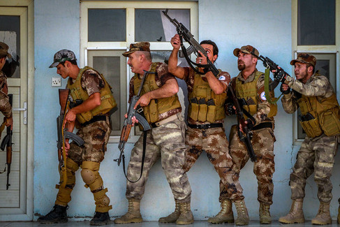 Members of the Nineveh Plains Protection Units (NPU) train to defend their villages from ISIS.  2015 Sharafia, Iraq
