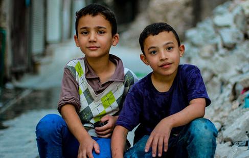 Two boys pose for a photo in Aleppo, Syria.  2017 Aleppo, Syria