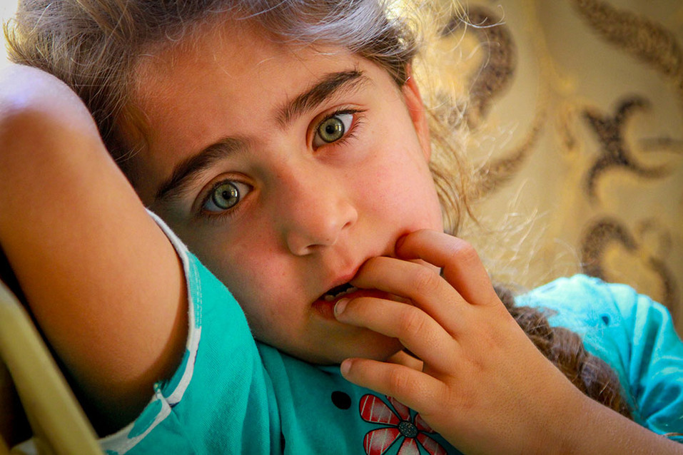 The face of an Assyrian child whose resilient family has devoted themselves to staying and defending their homes and community in Northern Iraq.   2015 Alqosh, Iraq