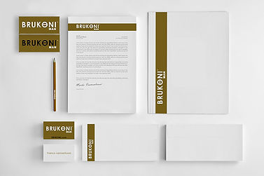 Brand identity package including letterhead, business cards, envelopes, pens, and more.