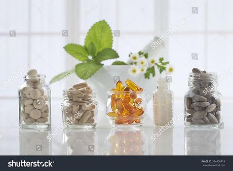 stock-photo-herbal-medicine-pills-and-mo