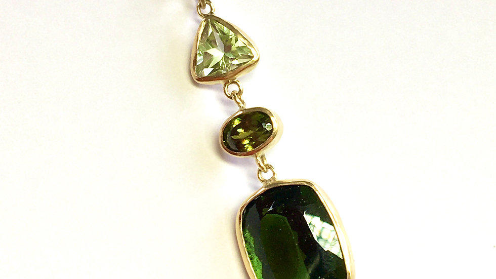 CA5 Huge luscious green facetted Moldavite set in 18ct gold