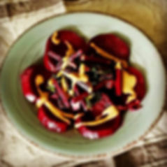 Beets topped with beet greens that have