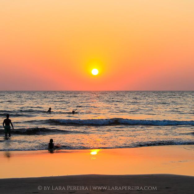 """The sun sets in Morjim Beach"""