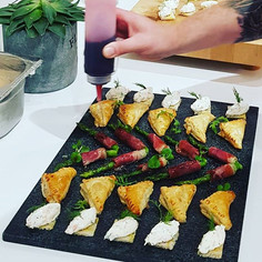 Finishing touches to last night canapes.