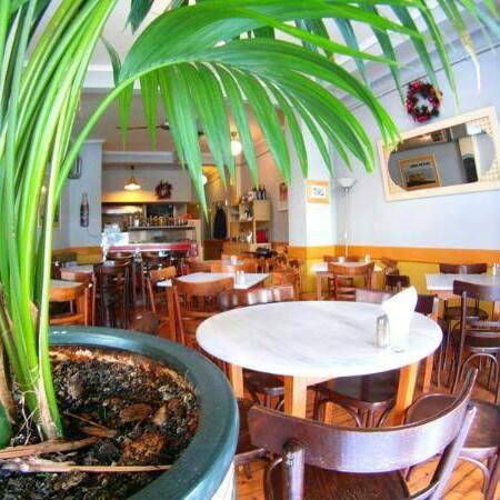 Green interiors of Greek restaurant Heavy Melon, traditional Mediterranean food