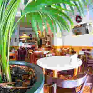 Green interiors of Greek restaurant Heavy Melon, traditional Mediterranean food