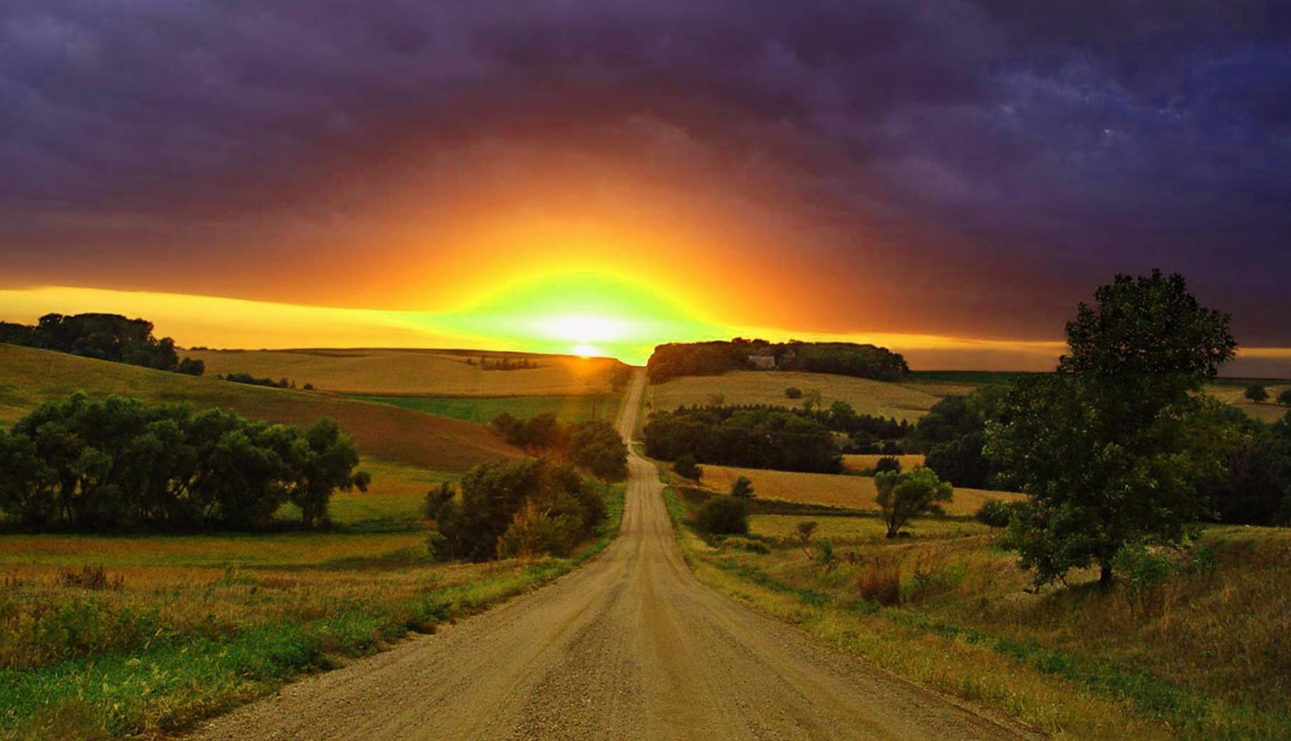 road-mountain-sun-greenery.jpg