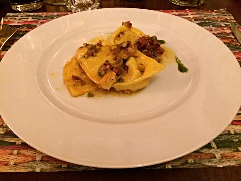Cappellacci di zucca con petto di anatra affumicata e pistacchio