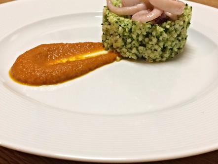Miglio con broccolo e calamaro su salsa allo zafferano e aria d'arancia