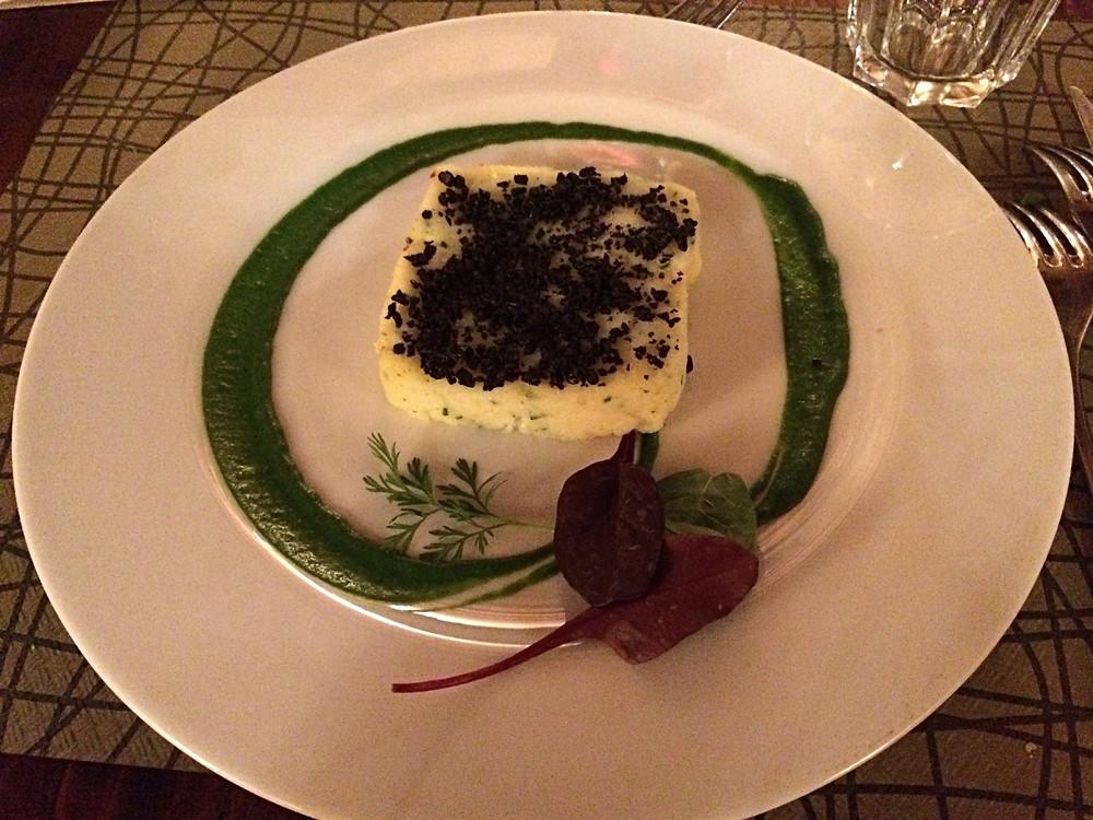 sformato tiepido di Baccalà mantecato, patata e polvere di olive nere