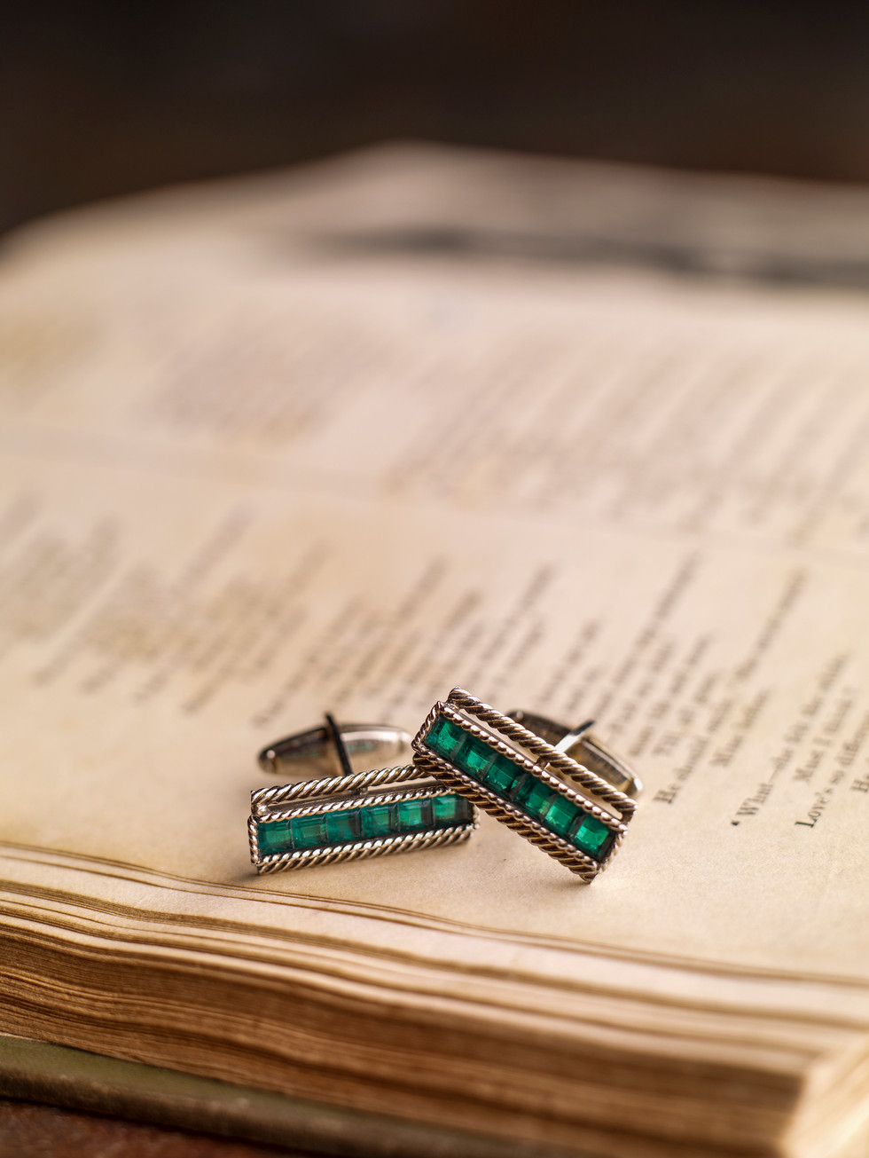 Antique Cuff Links On Book