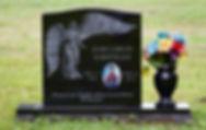 Headstone with memorial vase