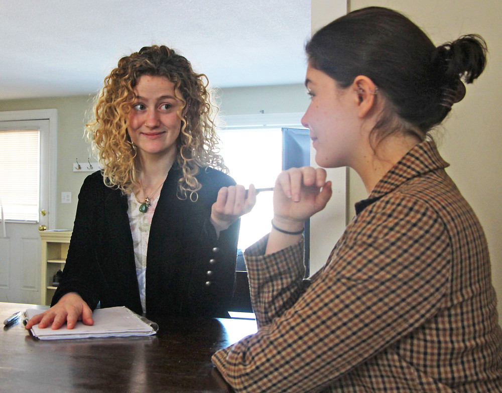 Julia Graves (left) and Alexis Memmolo (right) hold mock interviews in their shared home to practice answering commonly asked questions. Tuesday, Feb. 18th, 2020.