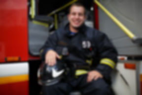 Photo of happy fireman looking at camera
