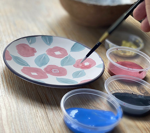painting plate with a thin brush.jpg