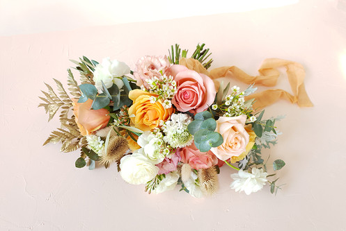 Bouquet of roses, scabiosa, wax flowers, ranunculus, gum and some dried ferns