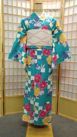 青藍笹竹牡丹市松化纖袷小紋