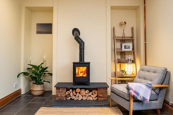 Wood burning stove with roaring fire. Stove installation by Dyfed Chimneys