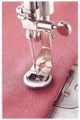 Pie para coser botones