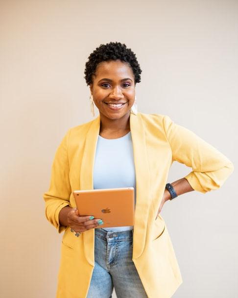 Woman holding iPad - 480x600.jpeg