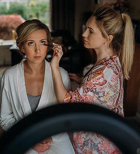 bride sitting wedding morning makeup