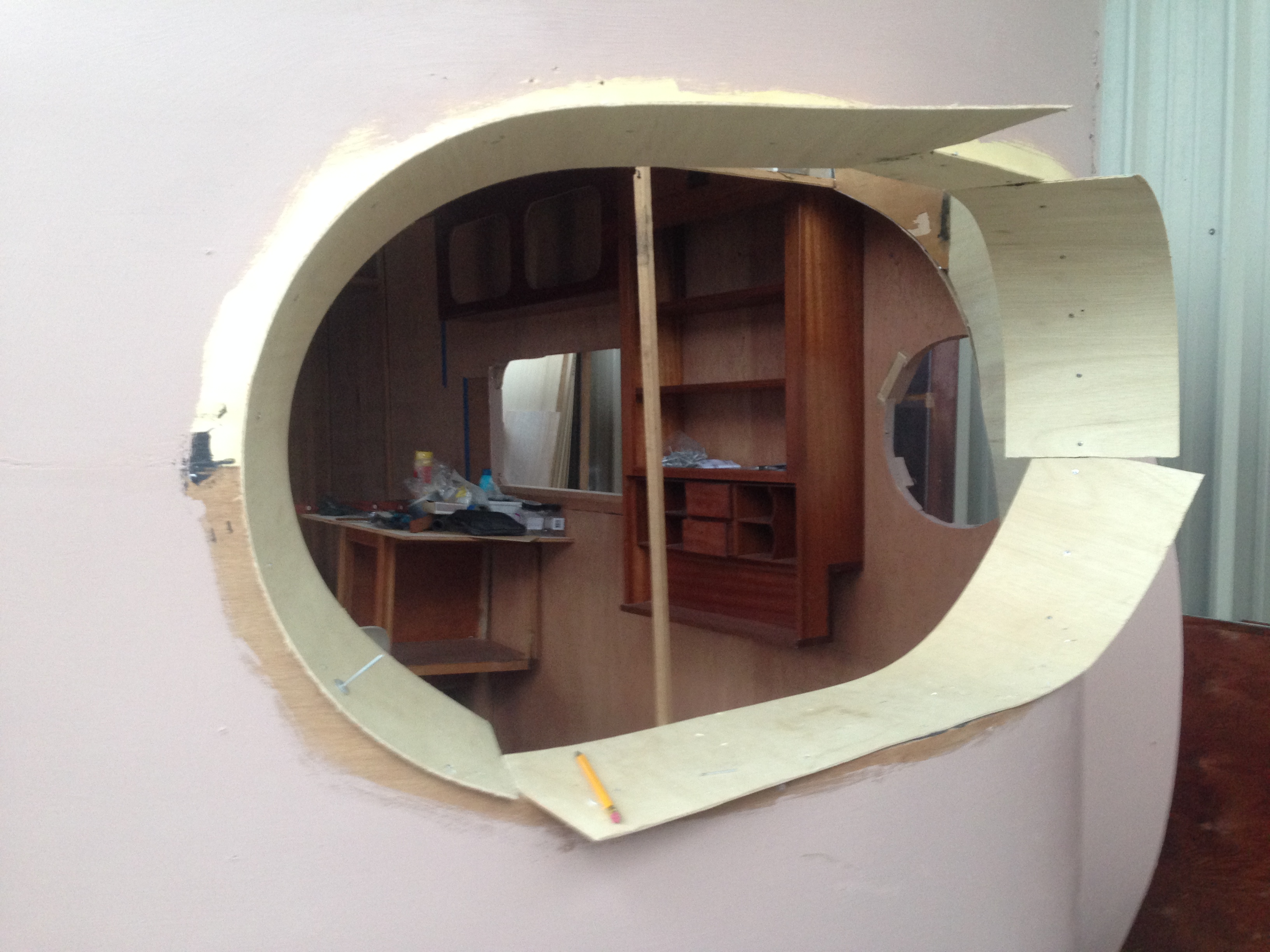 Plywood around front window