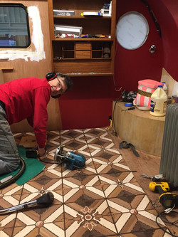 Walter working on parquet floor