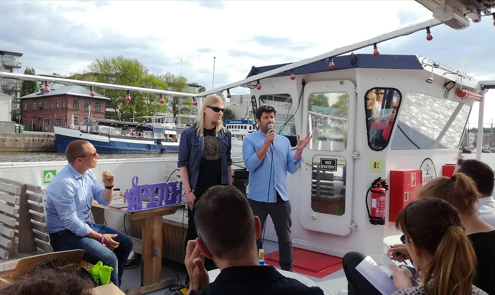 Mikko Herranen and David Oliva at the ferry giving a pitch.