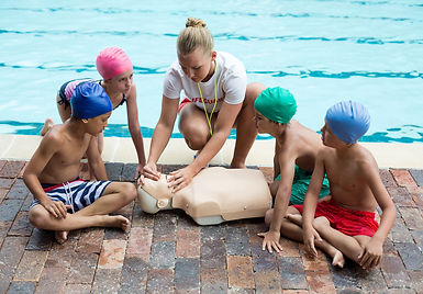 Female lifeguard giving rescue training