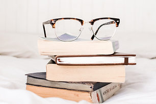 book pile glasses.png