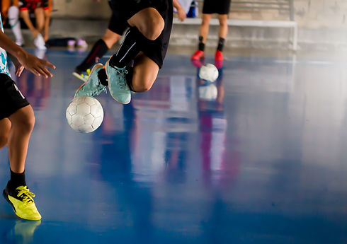 Futsal player  jump with trap and contro