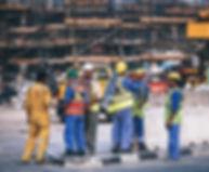 Workers in PPE Standing.jpg