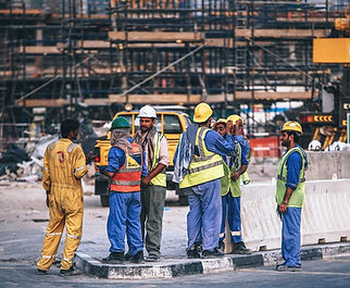 Workers in PPE Standing.jpg
