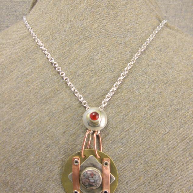 Drop rivet pendant necklace