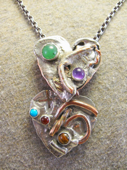Overlapping Hearts necklace detail