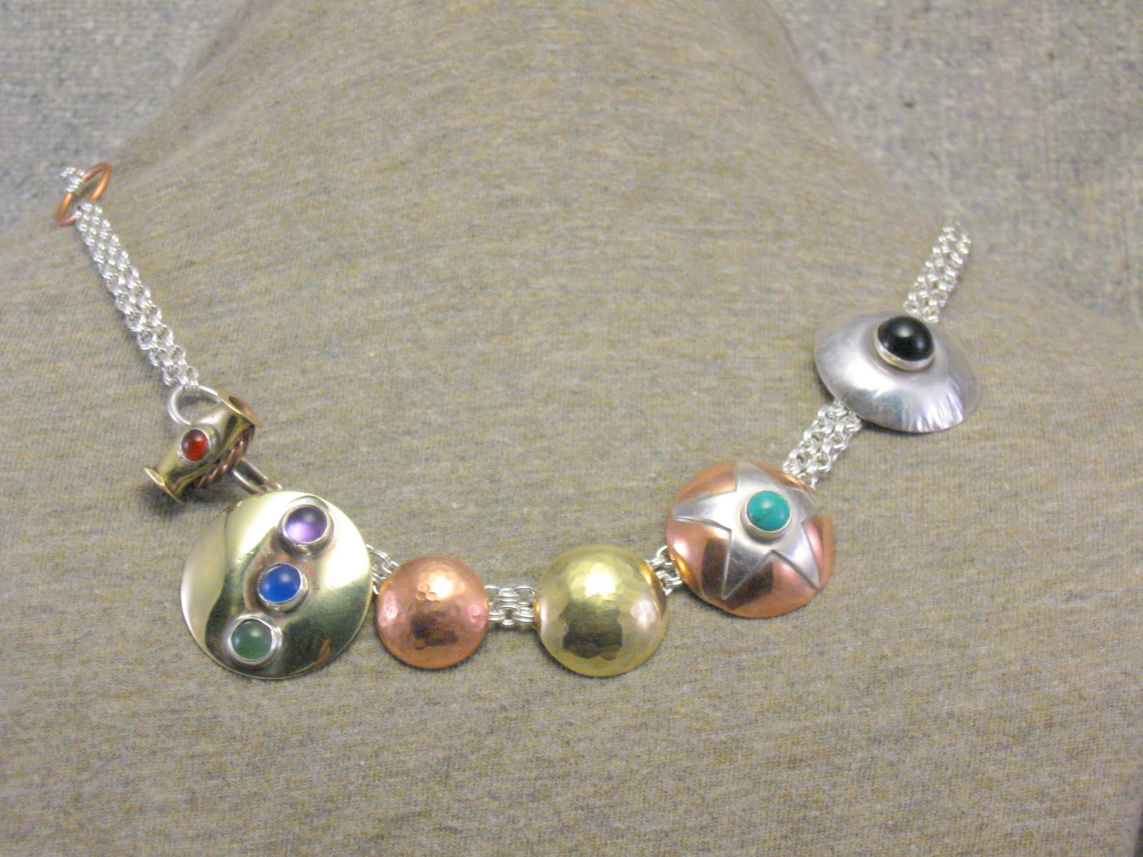 Toggled Dome Necklace. Slightly closer with domes moved a bit.JPG
