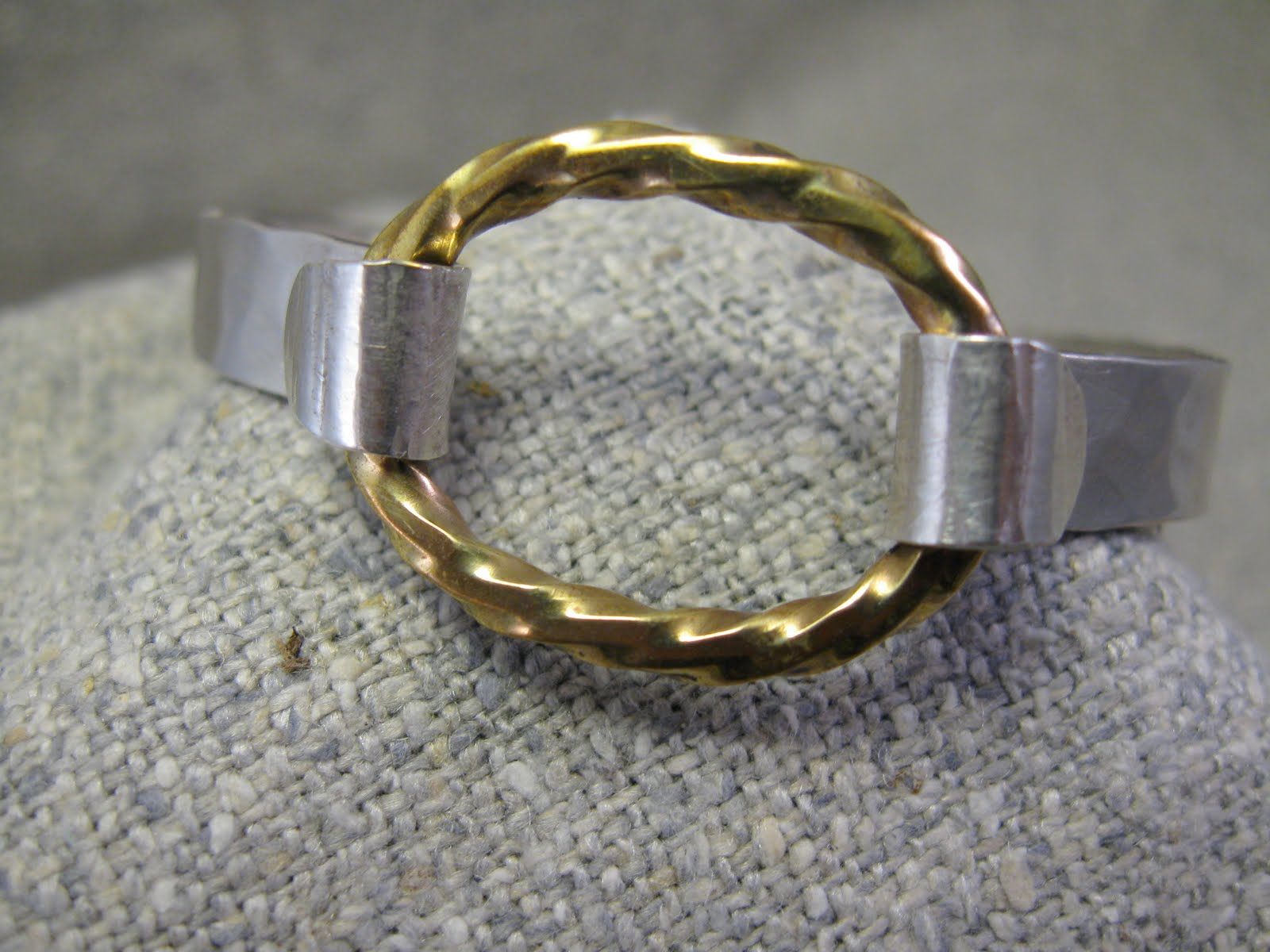 Von B (Detail- connector also included with bangle) Bangle with twisted brass ov