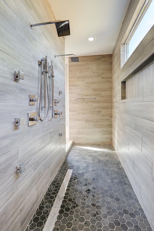 "<img src=""bathroom.jpg"" alt=""stunning neutral marble bathroom shower"">"