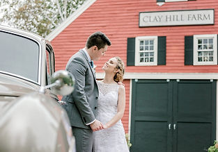 Bride and groom at the Clay Hill Farm red barn